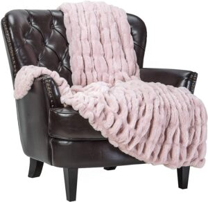 chair with pink throw blanket