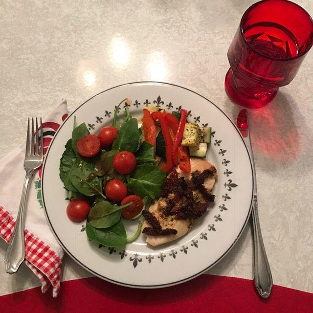 chicken and veggies on plate - sheet pan dinner
