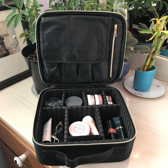 photo of open makeup case - travel accessory