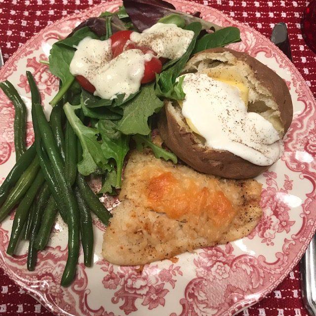 fish, baked potato, green beans, salad